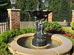 Custom built fountain with limestone coping