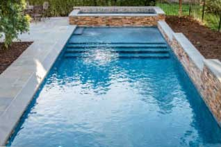 Residential swimming pool built by Eastern Aquatics